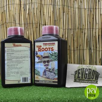 Top Roots de Top Crop , estimulador de raices en un recipiente negro junto con su tapón medidor transparente.